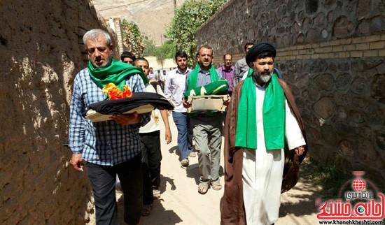 آئین بیرق گردانی در روستای داوران رفسنجان برگزار شد / عکس