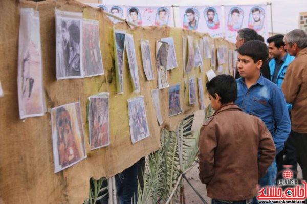 برپای نمایشگاه عکس های شهدا در بیست و سومین یادواره سرداران و ۶۵ شهید دهستان شریف اباد کشکوئیه رفسنجان